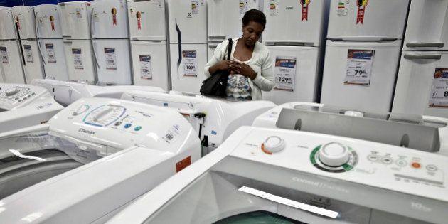 A customer looks at washing machines at a Casas Bahia store in the Rocinha slum of Rio de Janeiro, Brazil,...