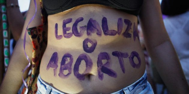 RIO DE JANEIRO, BRAZIL - MARCH 08: A supporter of legalizing abortion poses during a march for women's...