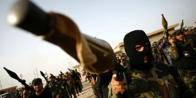 Members of the Saraya al-Salam (Peace Brigades), a group formed by Iraqi Shiite Muslim cleric Moqtada...