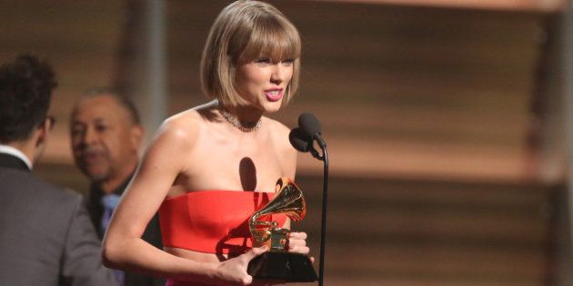 """Taylor Swift accepts the award for album of the year for """"1989"""" at the 58th annual Grammy Awards..."""