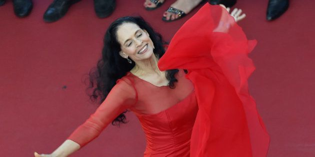 Brazilian actress Sonia Braga poses as she arrives on May 21, 2016 for the screening of the film 'Elle'...
