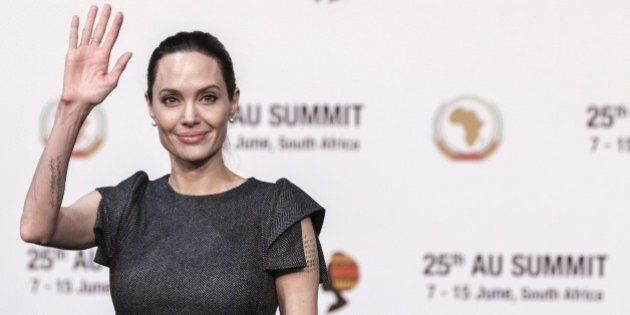 United States actress and UNHCR representative Angelina Jolie (C) waves ahead of a panel on Conflict related gender violence on June 12, 2015 during a session of the African Union Summit in Johannesburg, South Africa.AFP PHOTO/GIANLUIGI GUERCIA        (Photo credit should read GIANLUIGI GUERCIA/AFP/Getty Images)