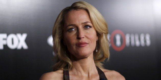 Cast member Gillian Anderson poses at a premiere