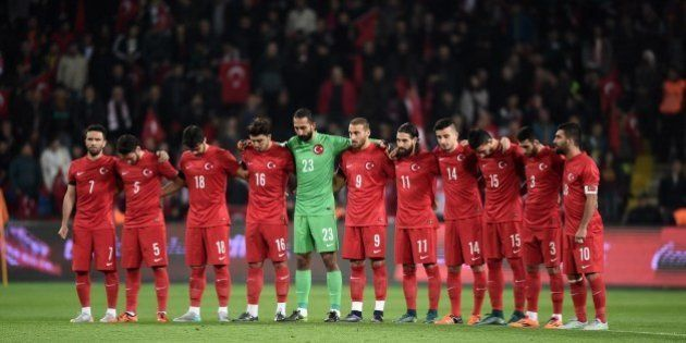Turkey's players observe a a minute of silence to pay tribute to victims of attacks claimed by Islamic...