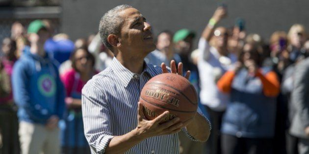 US President Barack Obama shoots a basketball during the annual White House Easter Egg Roll on the South...