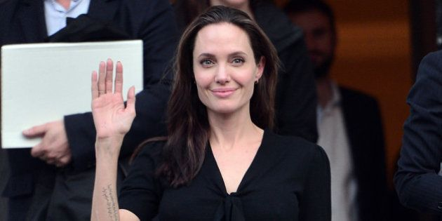 Hollywood star and UN refugee agency envoy Angelina Jolie gestures as she leaves the Greek Prime minister's...