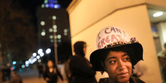 OAKLAND, CA - DECEMBER 4: Michaela Pecot wears a sign on her hat that reads 'I can't breathe' in front...