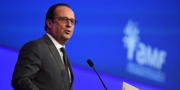 French President Francois Hollande delivers a speech during a meeting of French mayors in Paris on November...