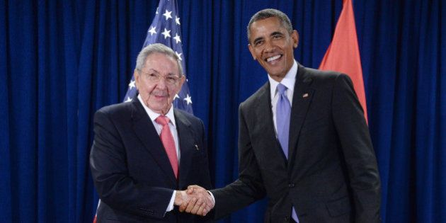NEW YORK, NY - SEPTEMBER 29: U.S. President Barack Obama (R) and President Raul Castro (L) of Cuba shake...