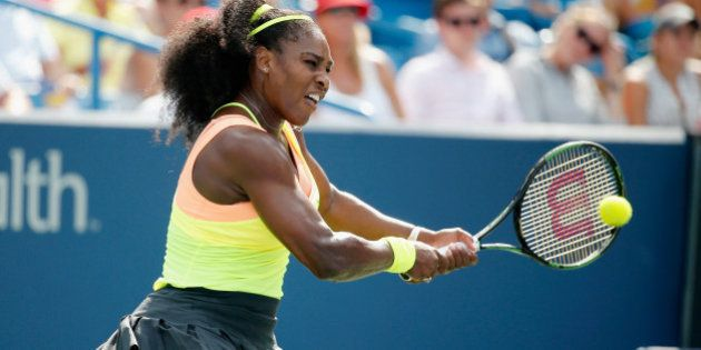 CINCINNATI, OH - AUGUST 23: Serena Williams returns a shot to Simona Halep of Romania during her win...