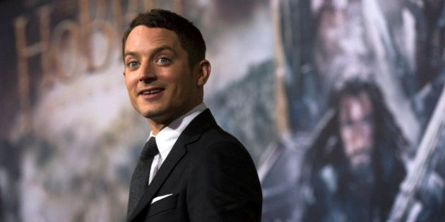 Actor Elijah Wood poses at the premiere
