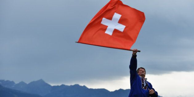 CRANS-MONTANA, SWITZERLAND - JULY 26:A man waves the Swiss flag during the final round of the Omega European...
