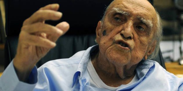 Brazilian architect Oscar Niemeyer speaks with AFP during an interview for his 102nd birthday, in his...