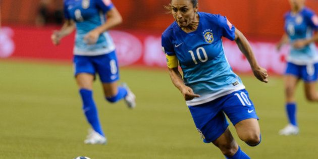 MONTREAL, QC - JUNE 13: Marta #10 of Brazil moves the ball during the 2015 FIFA Women's World Cup Group...