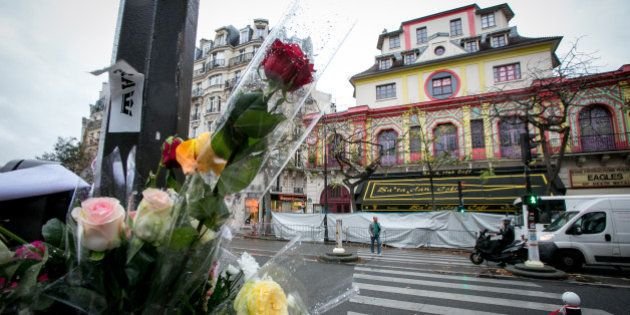 PARIS, FRANCE - NOVEMBER 19: Flowers are left near the 'Bataclan' concert hall on November 19, 2015 in...