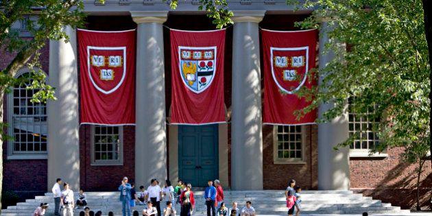 UNITED STATES - SEPTEMBER 03: Harvard banners hang outside Memorial Church on the Harvard University...