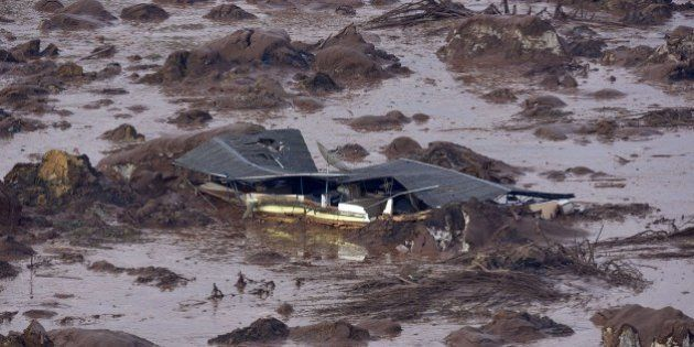A general view where a dam burst in the village of Bento Rodrigues, in Mariana, the southeastern Brazilian...