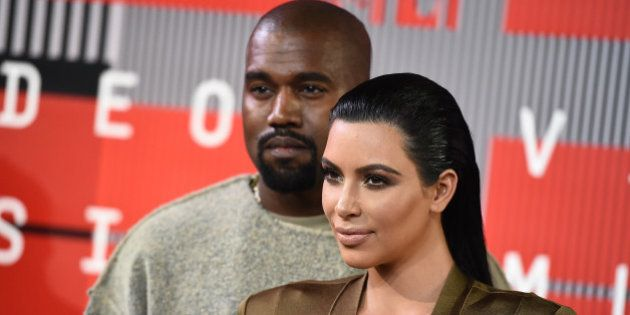 Kanye West, left, and Kim Kardashian arrive at the MTV Video Music Awards at the Microsoft Theater on...