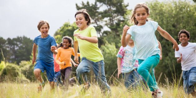 Children, aged 9-10, running together in a
