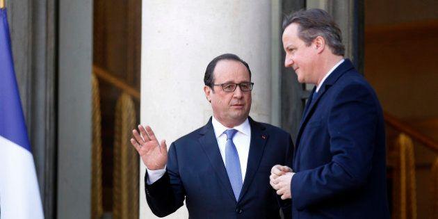 PARIS, FRANCE - NOVEMBER 23: British Prime Minister David Cameron (R) talks with French President Francois...