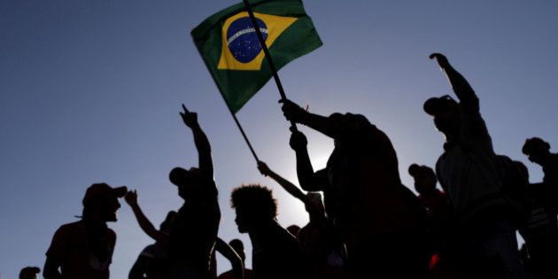 Members of the Landless Workers Movement (MST) take part in a protest against the impeachment of Brazil's...