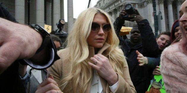Pop star Kesha leaves Supreme court in New York, Friday, Feb. 19, 2016. (AP Photo/Mary