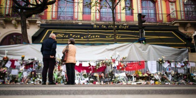 People stand in front of the Bataclan theatre in Paris on November 23, 2015 as they pay tribute to the...