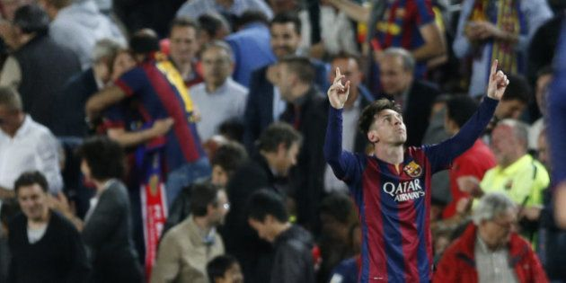Barcelona's Lionel Messi celebrates after scoring the opening goal during the Champions League semifinal...