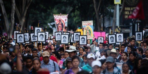 MEXICO CITY, MEXICO - DECEMBER 26: Protestors are seen during a protest for the 15 months of the disappearance...
