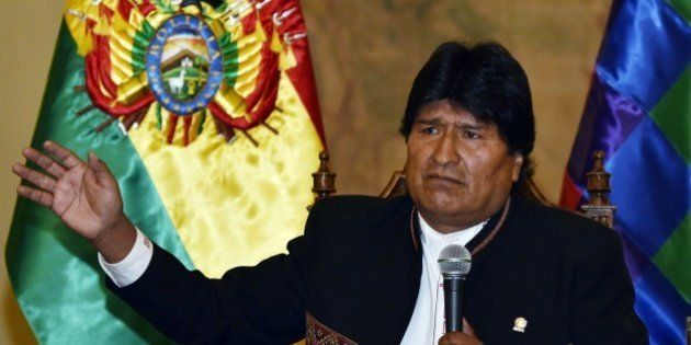 Bolivian President Evo Morales answers questions from the press at Quemado palace in La Paz on February...
