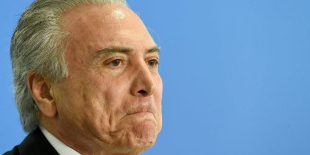 Acting Brazilian President Michel Temer delivers a speech during the swearing-in ceremony for the new...