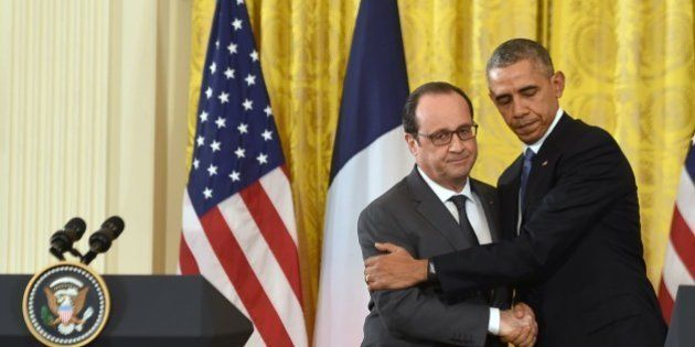 US President Barack Obama and French President Francois Hollande shake hands during a joint press conference...