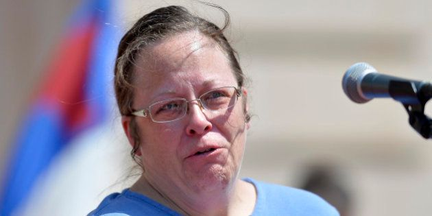 Rowan County, Ky. Clerk Kim Davis shows emotion as she is cheered by a gathering of supporters during...