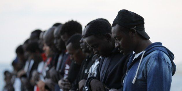 Migrants pray on the eve of the start of the Muslim holy fasting month of Ramandan, in Ventimiglia, Italy,...