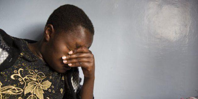 NAROK, KENYA - DECEMBER 25: Lato Caroline Gilisho, 17, sobs after recalling her story inside a dormroom...