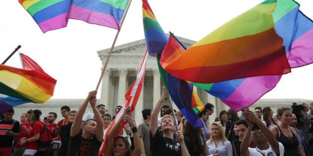 WASHINGTON, DC - JUNE 26: Same-sex marriage supporters rejoice after the U.S Supreme Court hands down...