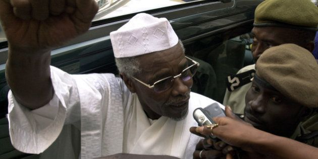 Former Chad President Hissene Habre makes declarations to media as he leaves a court in Dakar, Senegal...