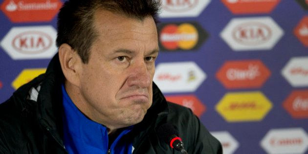Brazil's coach Dunga gestures during a press conference in Concepcion, Chile, Friday, June 26, 2015....