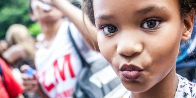 SAO PAULO, BRAZIL MARCH 8: Girl looks on during the International Women's Day celebration in Sao Paulo,...