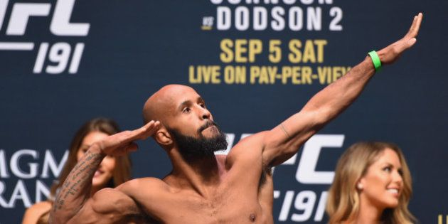 LAS VEGAS, NV - SEPTEMBER 04: Demetrious Johnson steps onto the scale during the UFC 191 weigh-in inside...
