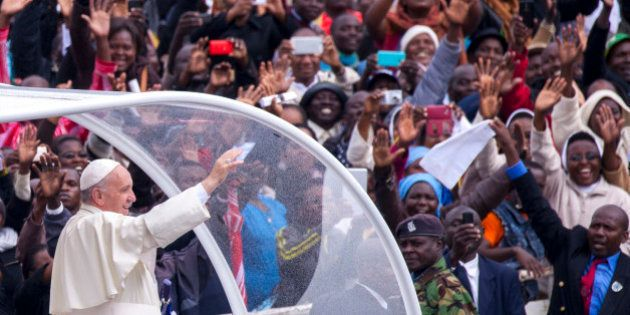 Pope Francis waves to the crowd at the University of Nairobi as he arrives to deliver a giant open-air...