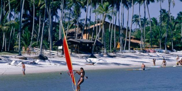 BRAZIL - CIRCA 1900: Club Med, winsurfing in Itaparica, Brazil. (Photo by Gerard SIOEN/Gamma-Rapho via...
