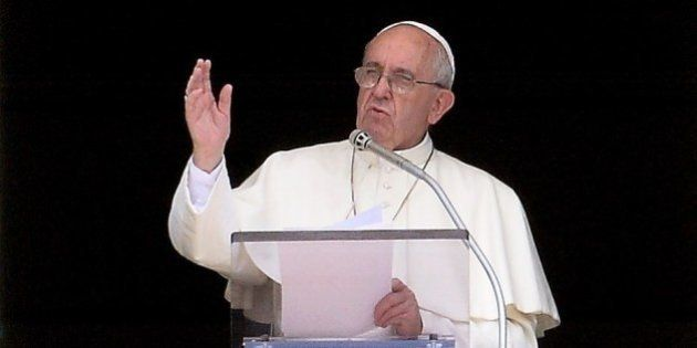 Pope Francis delivers his speach as he leads the sunday Angelus prayer from the window of his study overlooking...