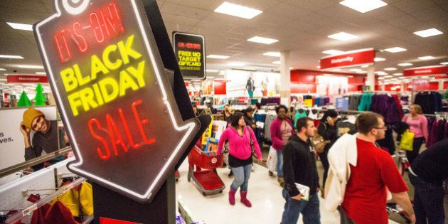 BRAINTREE, MA - NOVEMBER 23: Shoppers hurried through the aisles in Target during Black Friday at South...