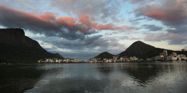 RIO DE JANEIRO, BRAZIL - DECEMBER 03: Stand-up paddle boarders pass on Lagoa Rodrigo de Freitas, which...