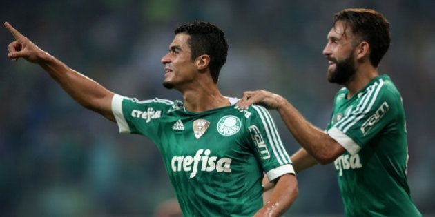 SAO PAULO, BRAZIL - APRIL 14: Egidio (L) of Palmeiras celebrates scoring the first goal with Allione...