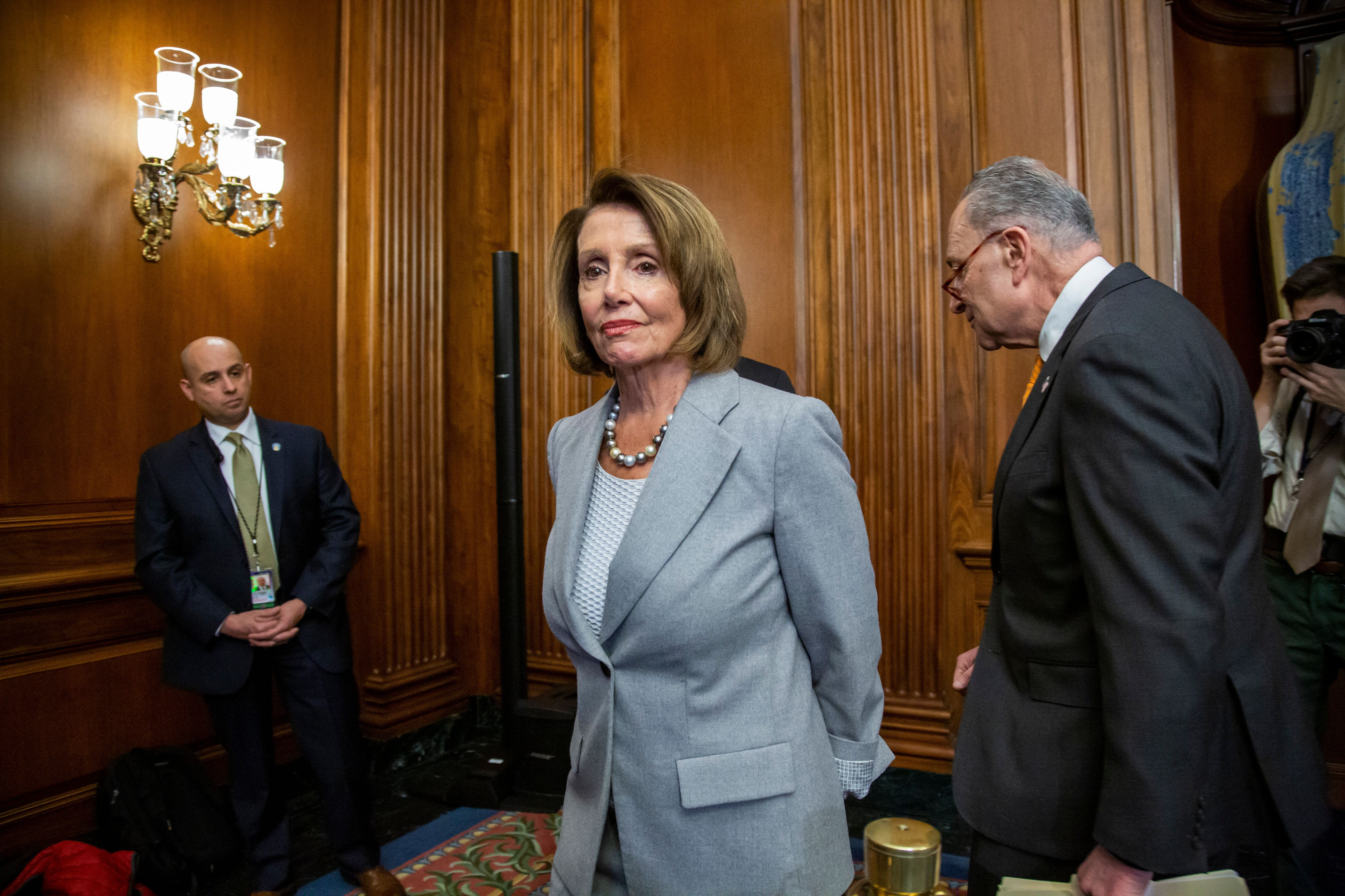 Speaker of the House Nancy Pelosi, D-Calif., and Senate Minority Leader Chuck Schumer, D-N.Y., right, leave an event with furloughed federal workers amid the partial government shutdown, on Capitol Hill in Washington, Wednesday, Jan. 9, 2019. Top Democrats say President Donald Trump walked out of a meeting with congressional leaders as talks to end the shutdown remain at an impasse. (AP Photo/J. Scott Applewhite)