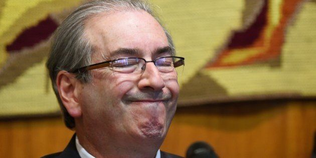 The president of the Brazilian Chamber of Deputies, Eduardo Cunha gestures during a meeting with party...
