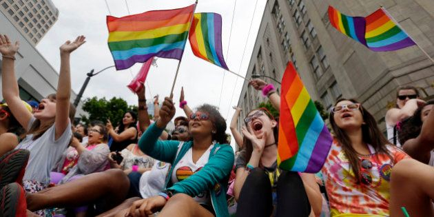 Parade viewers cheer at the 41st annual Pride Parade Sunday, June 28, 2015, in Seattle. Rainbows and...