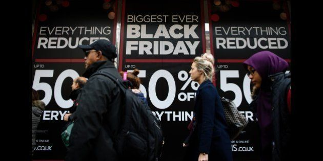 Retail stores display 'Black Friday' advertisements and banners on Oxford Street in central London, as...